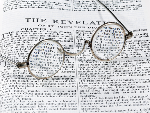 round reading glasses on Bible