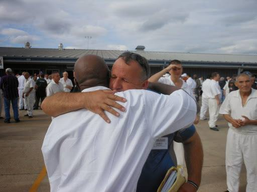 Inmate hugging friend