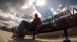 man sitting on a black bench