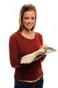 Young Woman Or Mother Holding Bible Teaching
