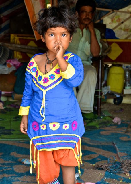 Child from India with colorful dress.